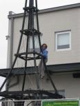 Corey Maxa stringing lights on the tower