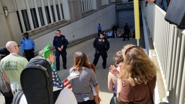 Protesters blocking the driveway to the garage at FERC headquarters