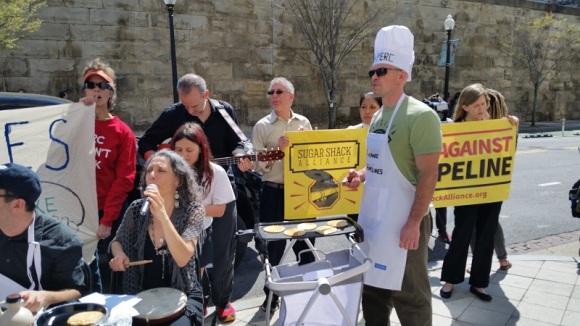Tim DeChristopher flipping pancakes