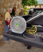 Les Grady and Rickie Wertz learning about the solar powered generator from Scott French.