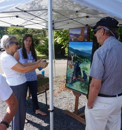Cathy admires Erin's work.