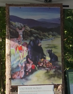 """The installed print of Erin's painting, """"A No Waste World,"""" is dedicated to all composting efforts in Harrisonburg!"""